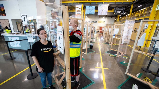 Amazon associate in a fulfillment center following additional safety proceedures in response to the COVID-19 pandemic