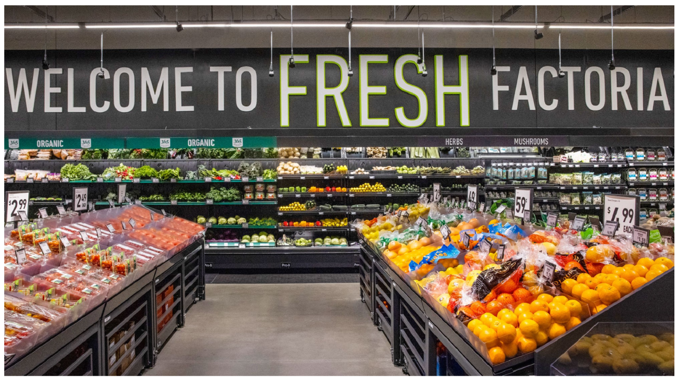 The fully stocked produce section of the new Factoria Amazon Fresh store. A sign above the produce reads, welcome to fresh Factoria.