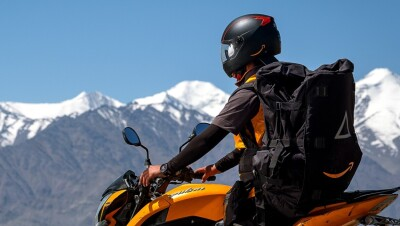 A Delivery Associate makes a delivery at Leh