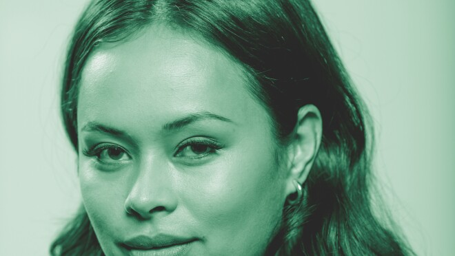 """Frankie Adams, from the Amazon Originals series """"The Expanse"""" poses for a photo. The image has been treated with a green filter."""
