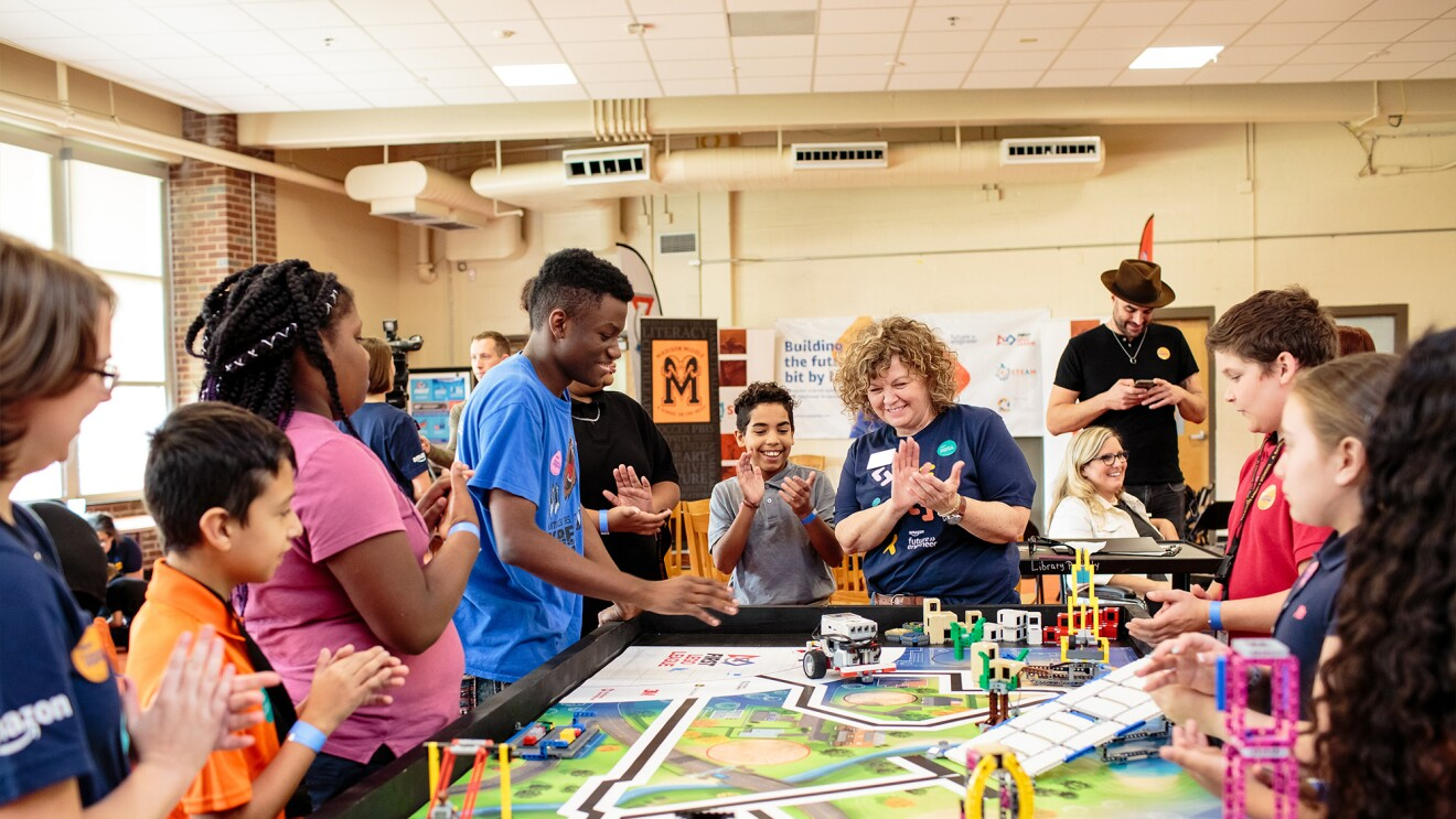 Students crowd around a STEM project at Metro Nashville Public Schools