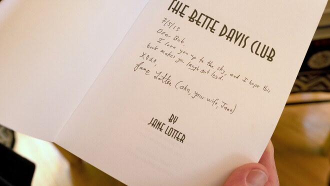 The inside cover of The Bette Davis Club, with a handwritten note to the author's husband.