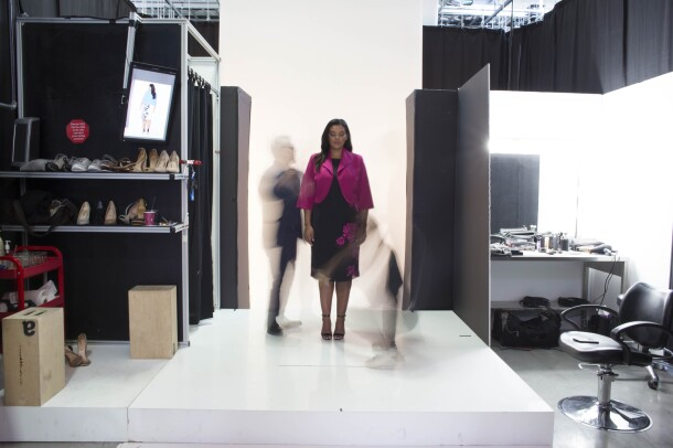 An Amazon Fashion model, wearing a pink and black suit, is photographed at Amazon Fashion's studios.