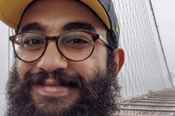 "A photo of Mohammad Ahmad, Amazon Future Engineer ""Teacher of the Year"" award recipient and teacher at KIPP Columbus High."