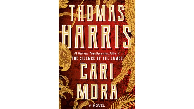 """Book cover for the novel """"Cari Mora"""" shows tall, ivory letters with the author's name, and the book title. The background is a deep red, with golden plant leaves swirling about."""
