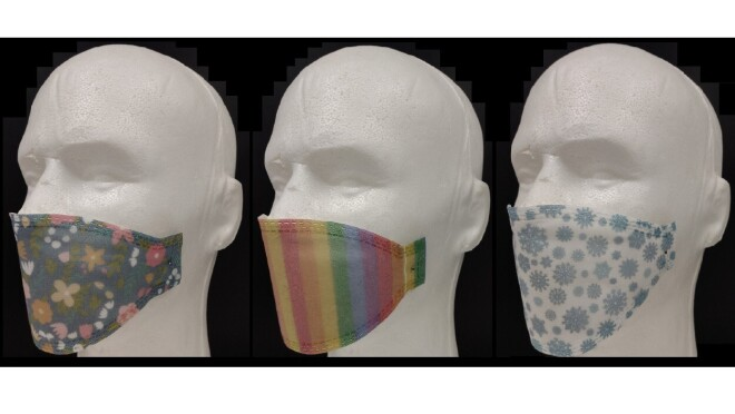 Three mask prototypes showcasing three different designs with colors, shapes, and patterns.