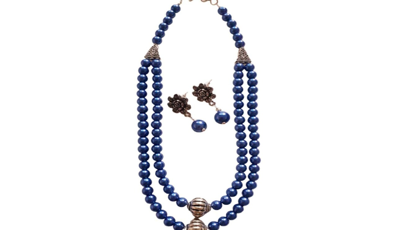 Blue created pearls with metal accent, necklace and matching earrings