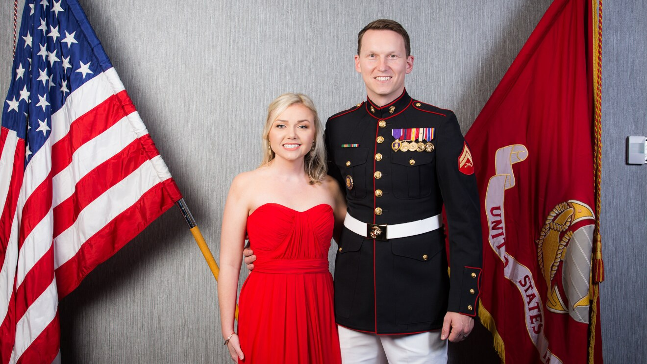 A man poses with his wife at a military event