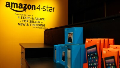 A table inside the Amazon 4-star store in New York City. On the table are Amazon Devices, including the Fire HD, Echo, and Echo Show.