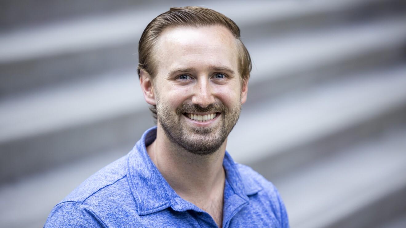 A bearded man in a blue shirt.
