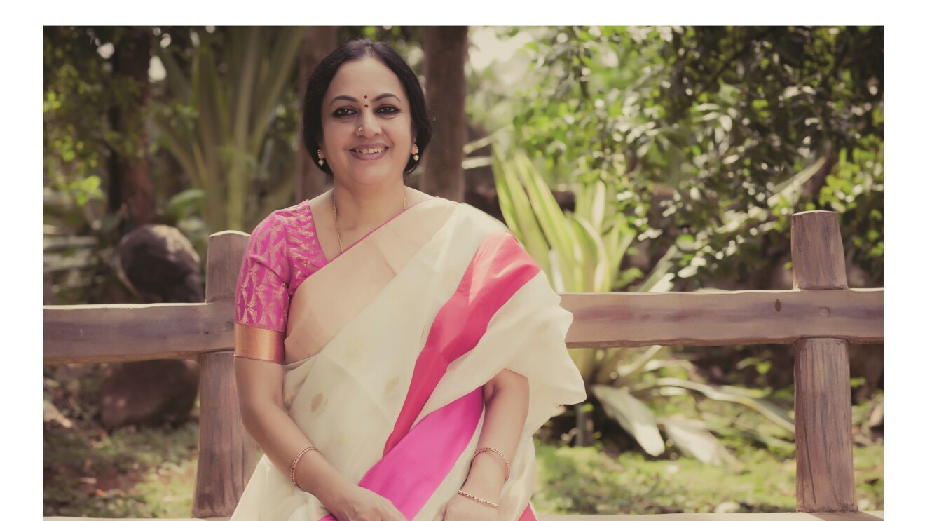 Author Bhanumathi sits on a bench as she poses for a pic