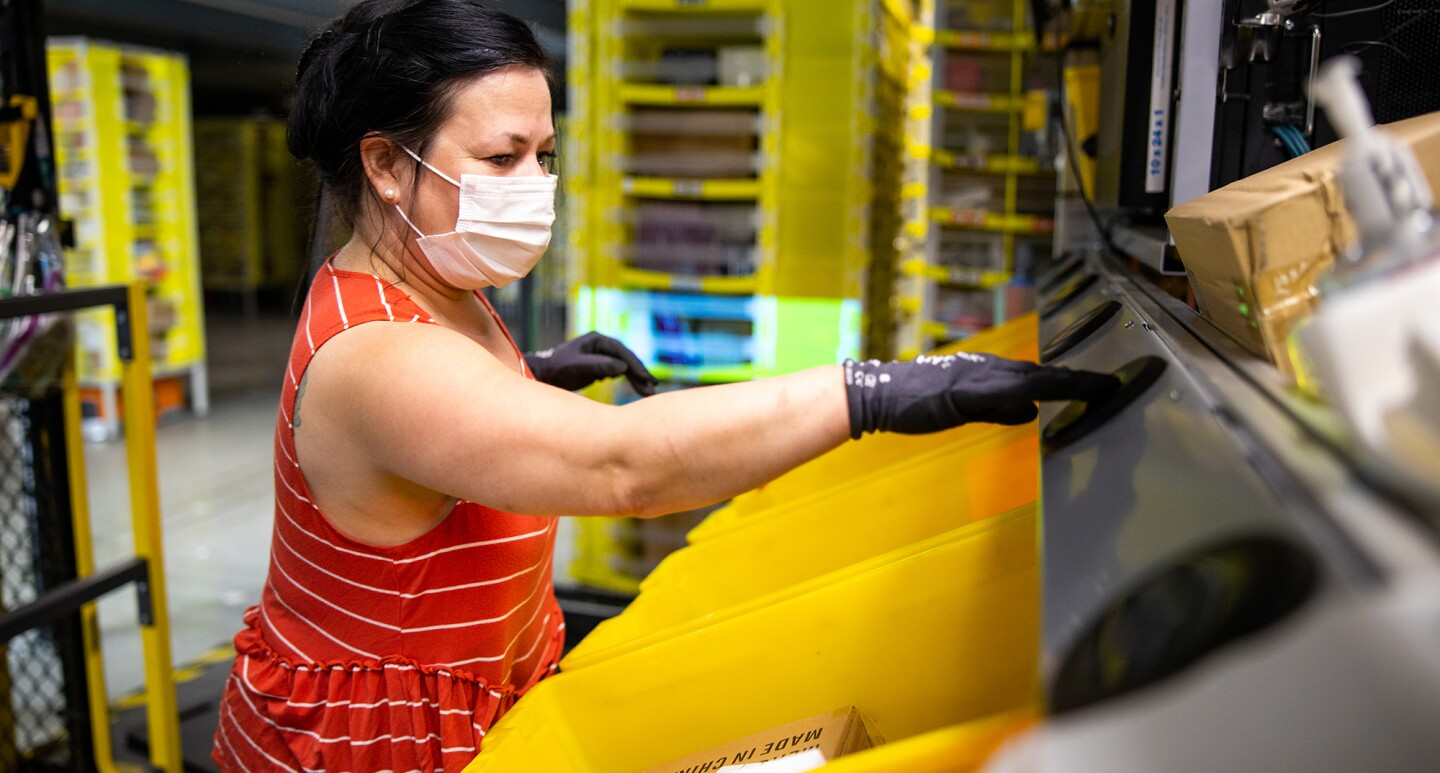 Amazon associate wears a mask while working. Photo taken during the COVID-19 pandemic.