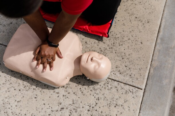 CPR instructor Jamie Davis demonstrates chest compressions