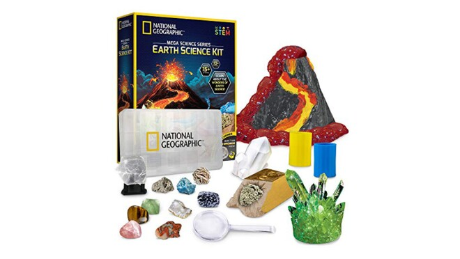 An image of a science kit with a volcano, a magnifying glass, crystals, and other accessories for science experiments.