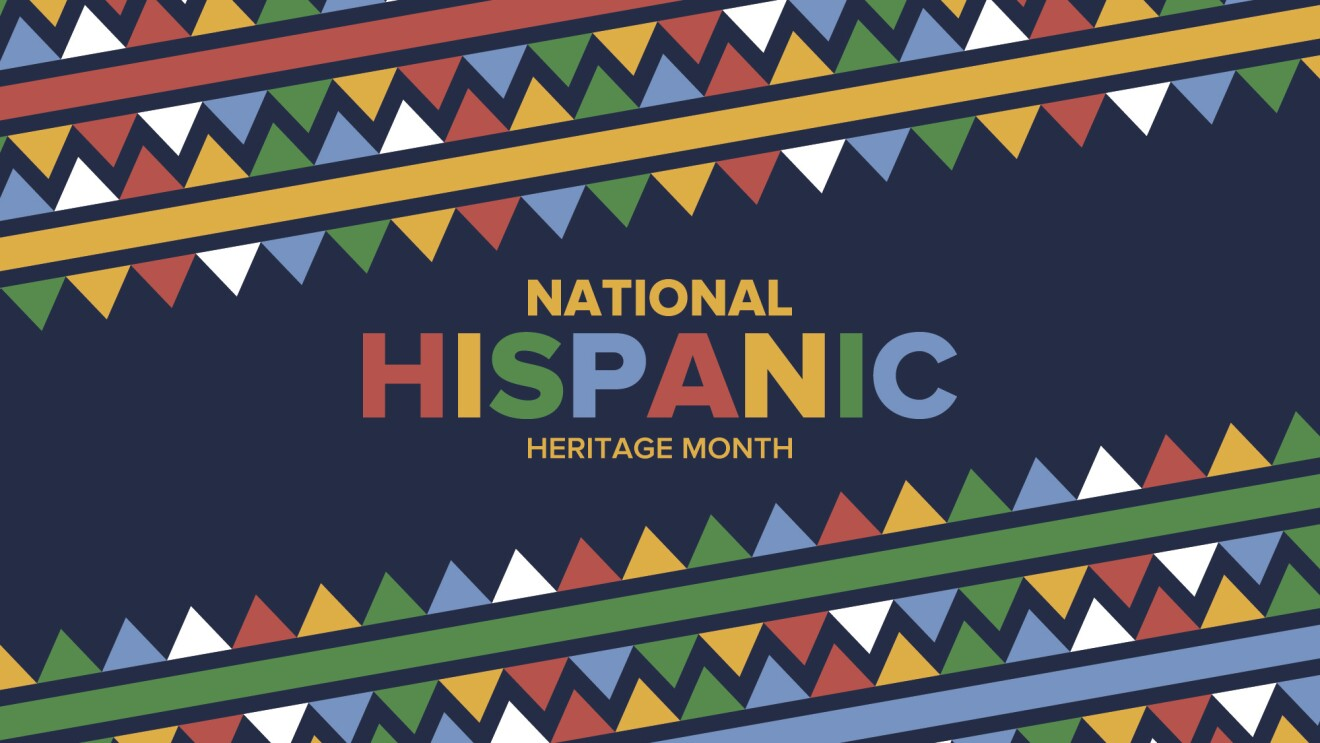"An illustration on a blue background with multicolored flags and ""National Hispanic Heritage Month"" in text"