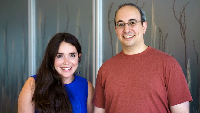 A woman (L) and man (R) smile at the camera. Both are Amazon employees who support code.org