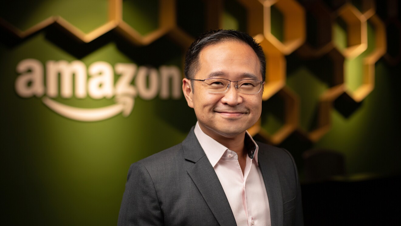 Henry Low standing against an Amazon background in Singapore