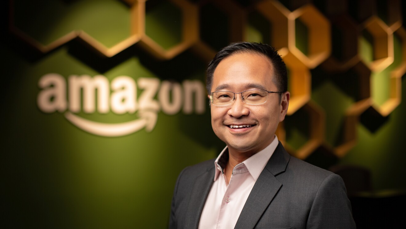 Mr Henry Low, Country Manager at Amazon Singapore, against a backdrop of the Singapore office