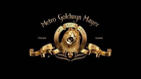 Trademarked logo for Metro Goldwyn Mayer in gold, on black background