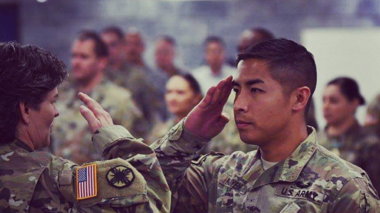 U.S. Army Reservist Lee Nguyen salutes to another soldier.