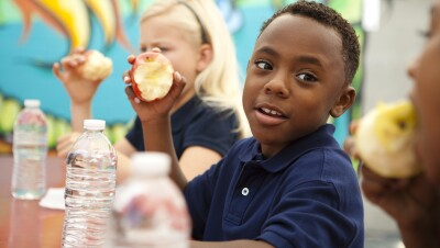 No Kid Hungry - kids in a school setting eating