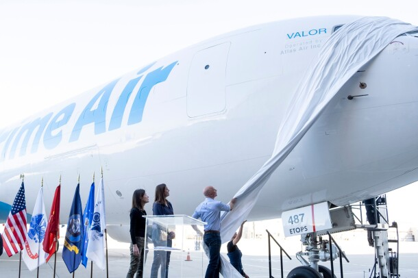 "Jeff Bezos unveils the name of a new Prime Air plane, ""Valor"" at an event to announce the plane on Veterans Day."