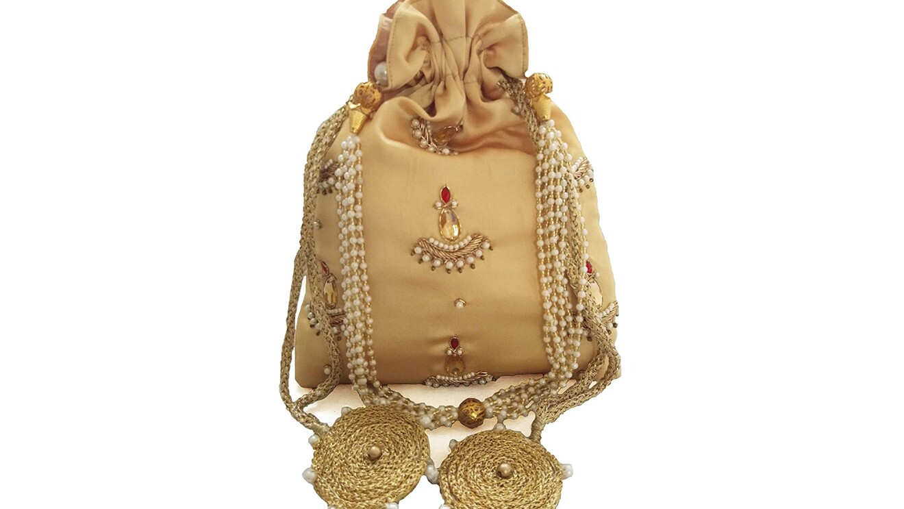 A gold potli with beaded/pearl and rope detail