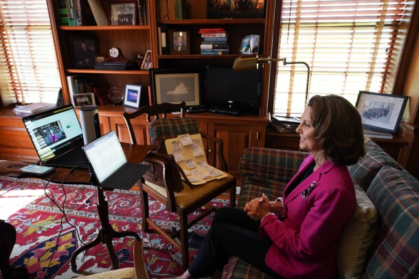 A woman on a laptop computer, working from home