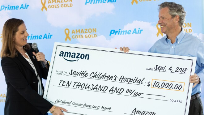Sarah Rhoads, director of Amazon Air presents a $10,000 donation to Seattle Children's Hospital for Childhood Cancer Awareness Month.