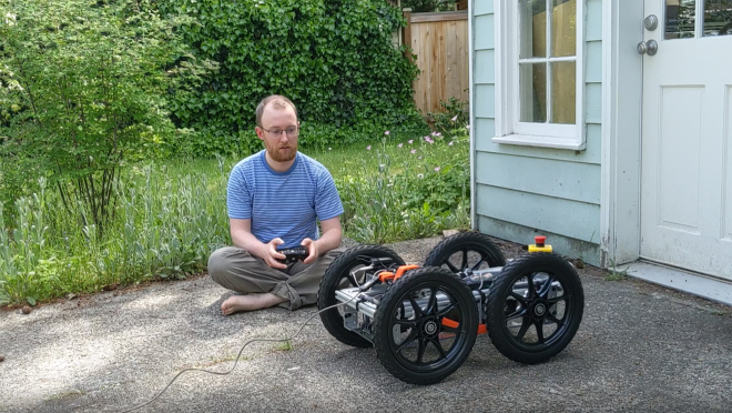 Amazon employee working on robotics advancement from his garage during the pandemic