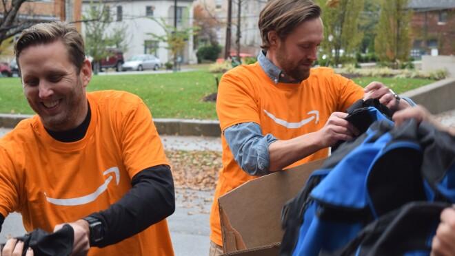 Amazon associates unload backpacks full of essential supplies