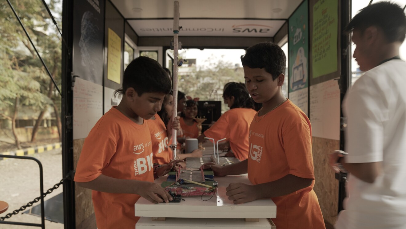 Kids work on a Science project in the STEAM bus