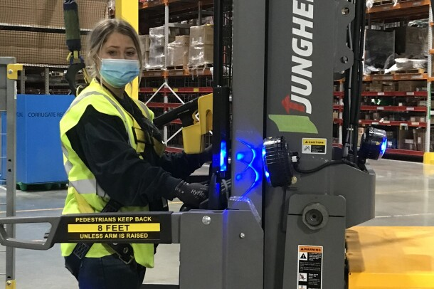 Amazon employee working at a fulfillment center