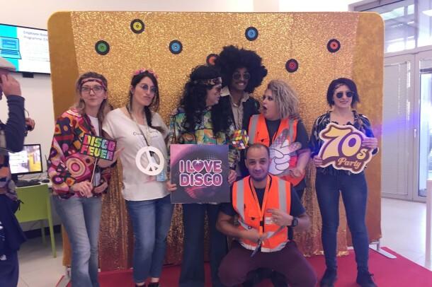 Amazon associates in our Milan fulfillment center participate in a 70s theme