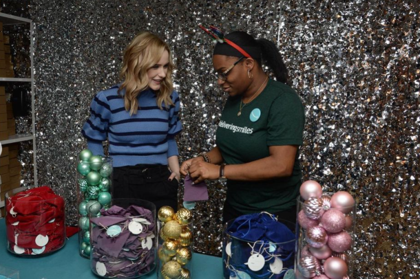 An image of two women putting together gift bags at a holiday party last year.