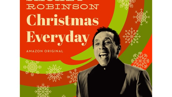 """Smokey Robinson album cover, with Smokey, in black and white, appearing to be singing. A red speech bubble is coming out of his mouth, and says """"Smokey Robinson, Christmas Everyday."""" Behind him are red and green concentric circles, with snowflakes overlaid on the circles."""