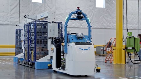 An image of a large robotic device pulling carts at an Amazon fulfillment center.