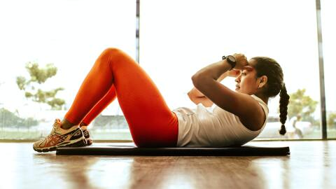 A girl doing crunches