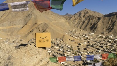 An Amazon box against the backdrop of Leh
