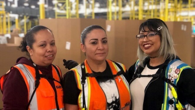 Amazon associates at San Bernardino pose for photos during Cyber Monday.
