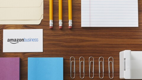 Amazon Business card surrounded by office supplies