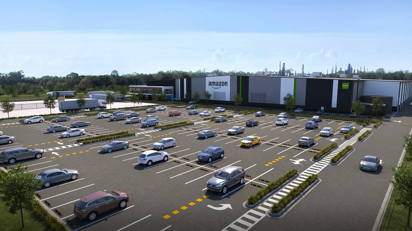 An Amazon fulfilment centre, surrounded by landscaped grounds and a large parking lot