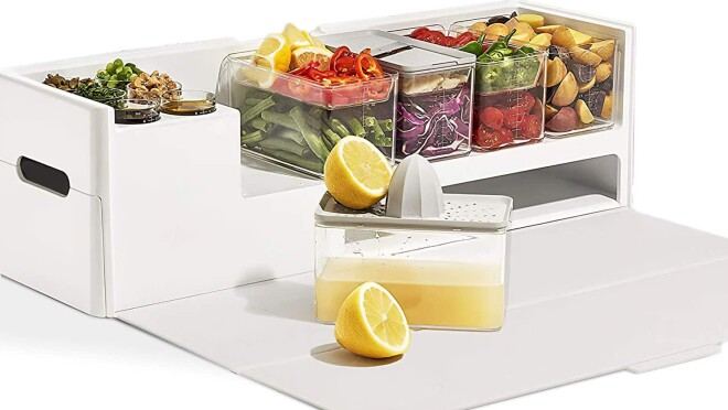 An image of a white container with smaller clear containers stacked on top of it. There is a drawer and a container with a lemon being strained into one of the clear containers.