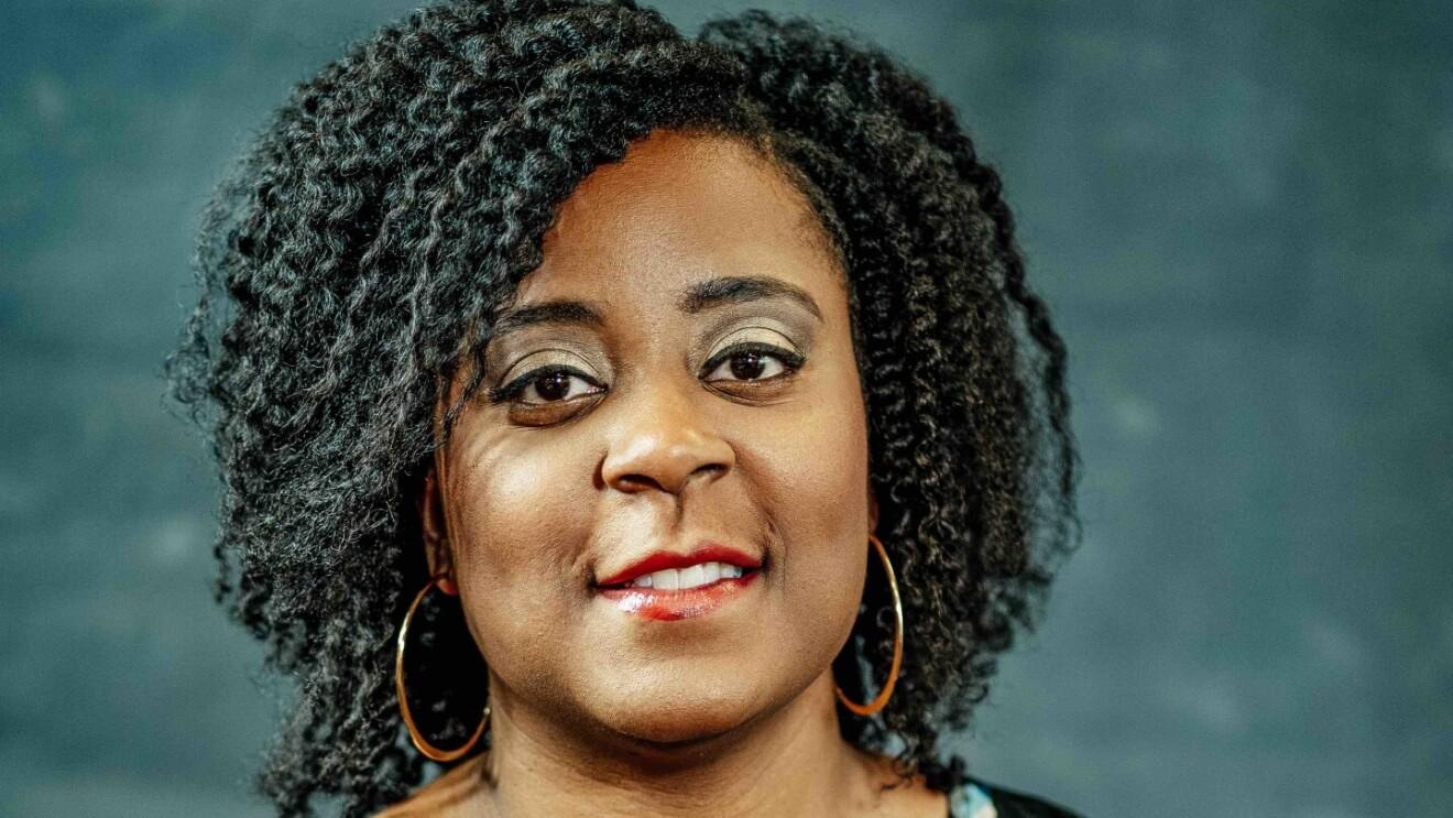 An image of Dr. Nashlie Sephus, a Black woman wearing gold hoop hearings.