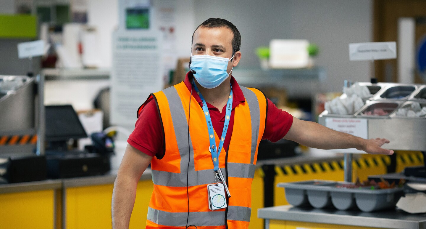 Amazon employee, Aman Thukral, wears a face mask and gives a tour of the new safety measures in fulfillment centers.