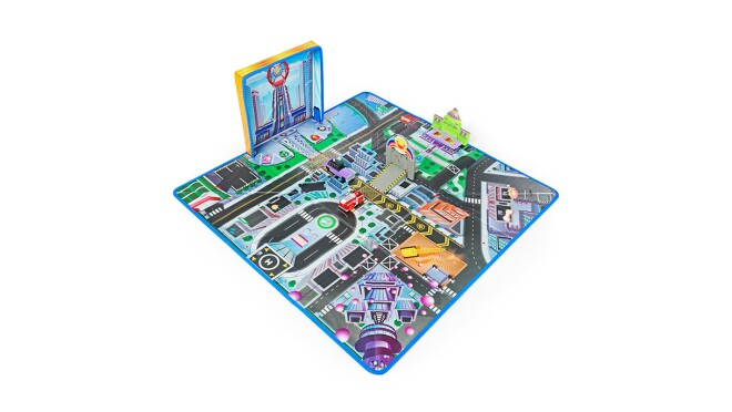 An image of a play mat with roads and city structures on it. There is a blue outline on the mat and some structures and trees are sticking out of it.