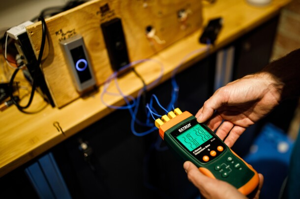 A device measures the output of prototype Ring doorbells.
