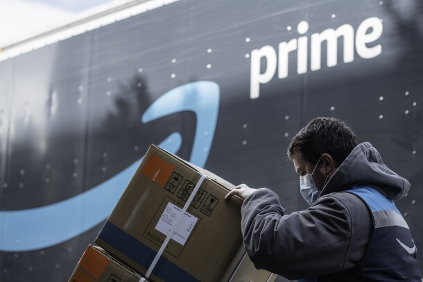 An Amazon driver delivers boxes of medical supplies.