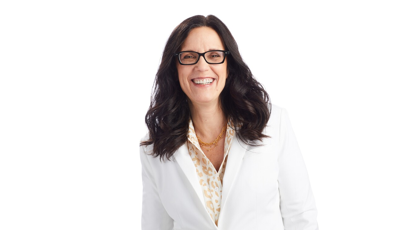 An image of Debra Chrapaty smiling for a professional photo against a white background.