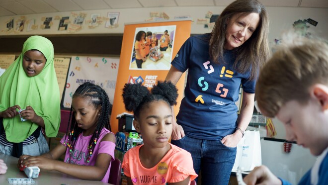 Amazon SVP Beth Galetti works with students at John Muir Elementary in Seattle as part of the Amazon Future Engineer program.